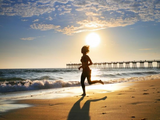 girl running on beach 550x412 10 Ways to Boost Your Brain Power