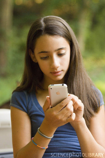 Teenager on iPhone