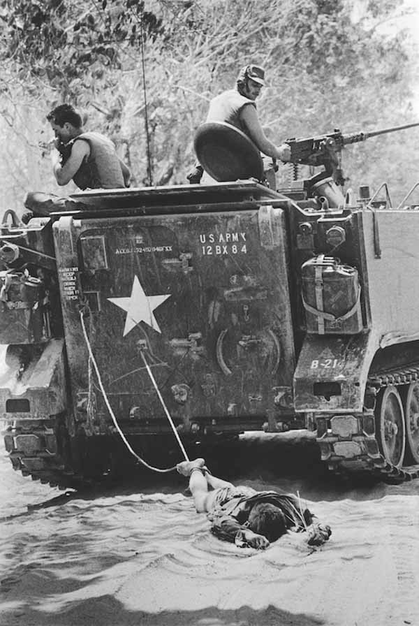 American Soldiers Dragging Viet Cong
