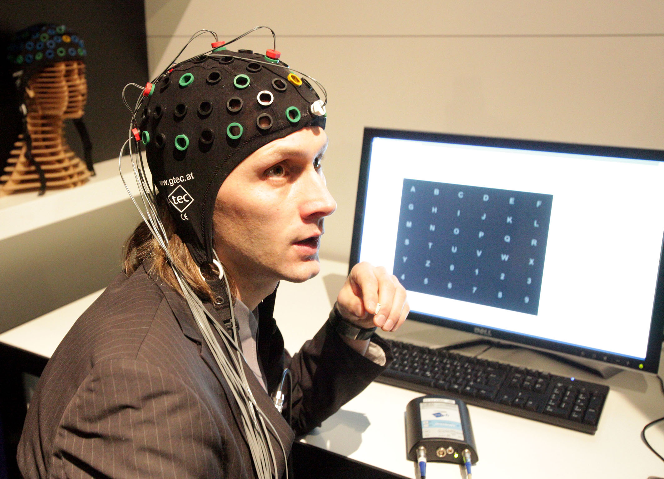 brain computer interface A brain-computer interface (bci) is a device that directly translates brain signals  into actions for computer software, such as a text editor, or a device, such as a.